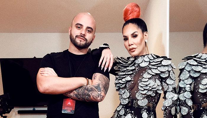 Erick Márquez junto a Ivy Queen